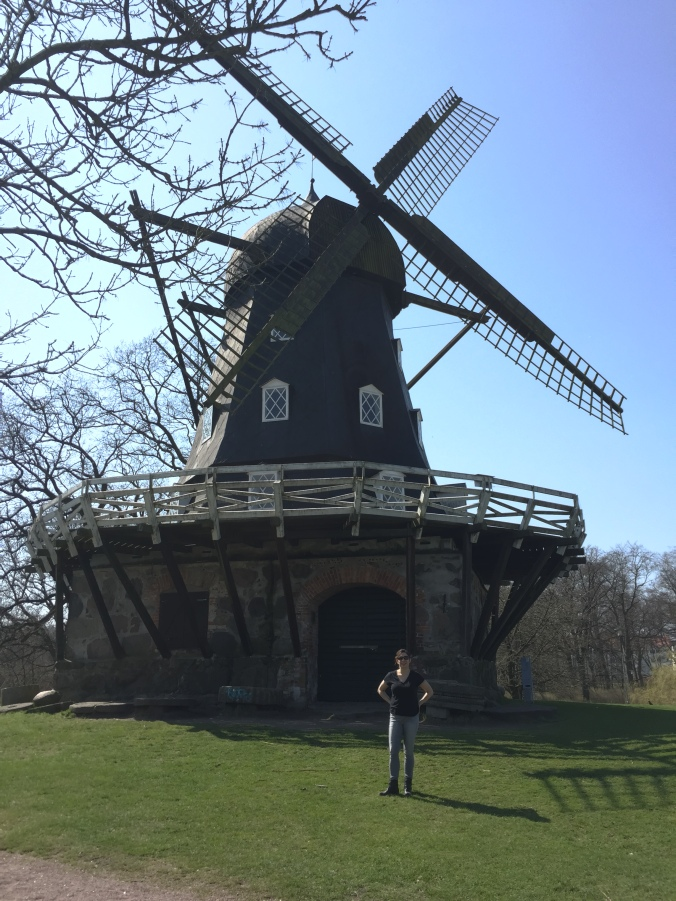 woman standing in front of a windmill