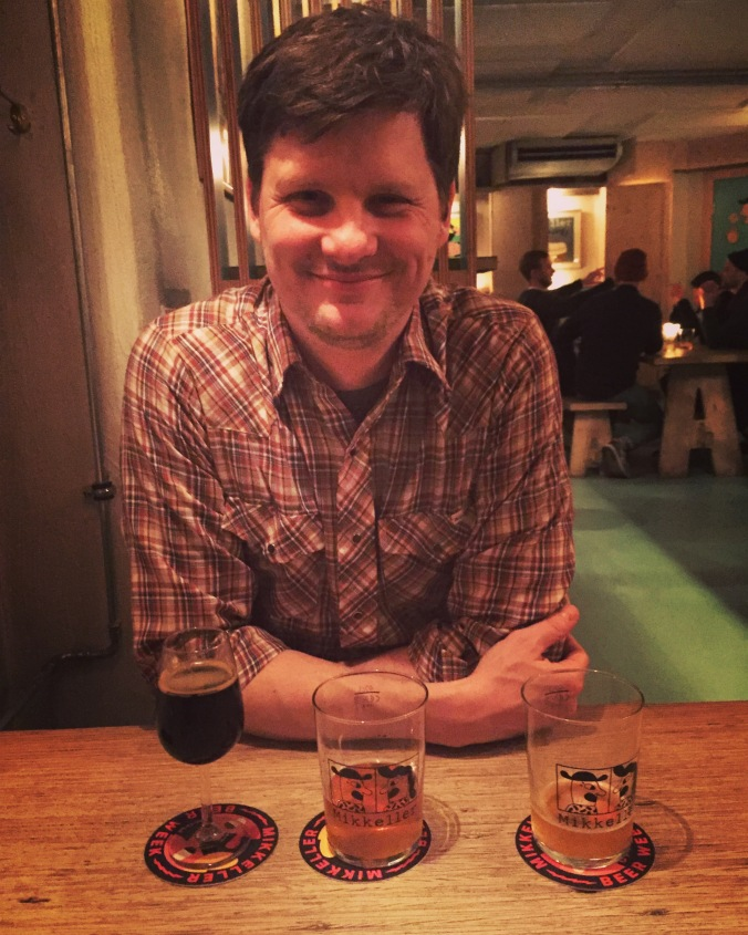 man in bar with three glasses in front of him