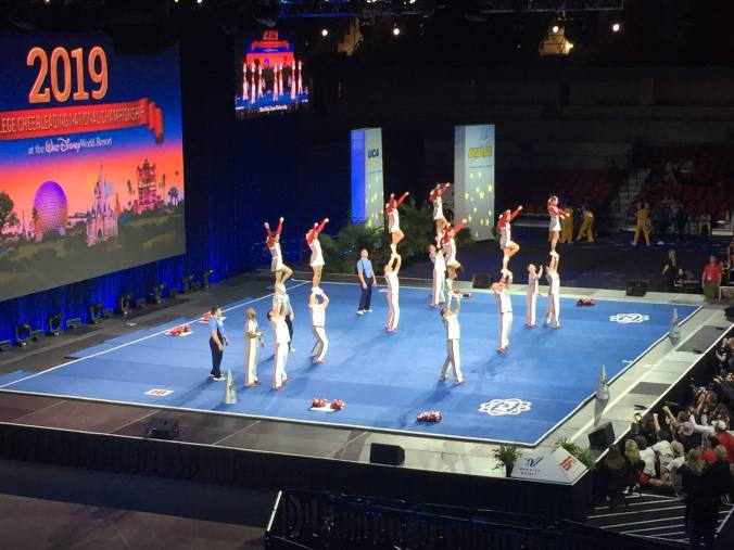 a coed squad performs at the college cheerleadiing national championships